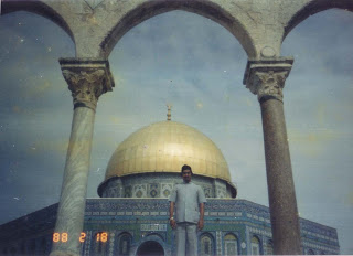 His Eminency Shah Sufi Mohammed Dr. Nurul Alam standing infront Of Moshjidul Aqsa in Jerusalem.